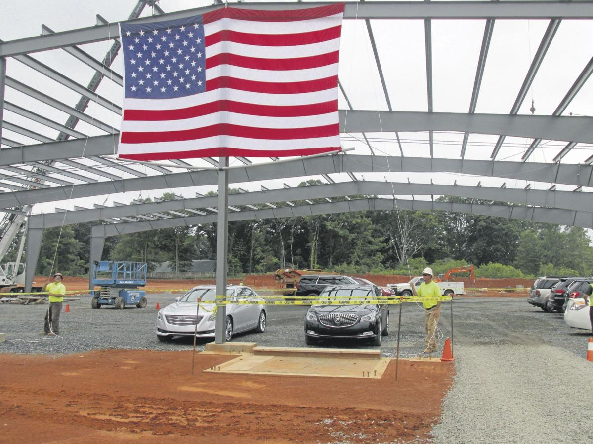 Randy Marion Statesville >> Randy Marion raises flag on new Ford dealership location ...