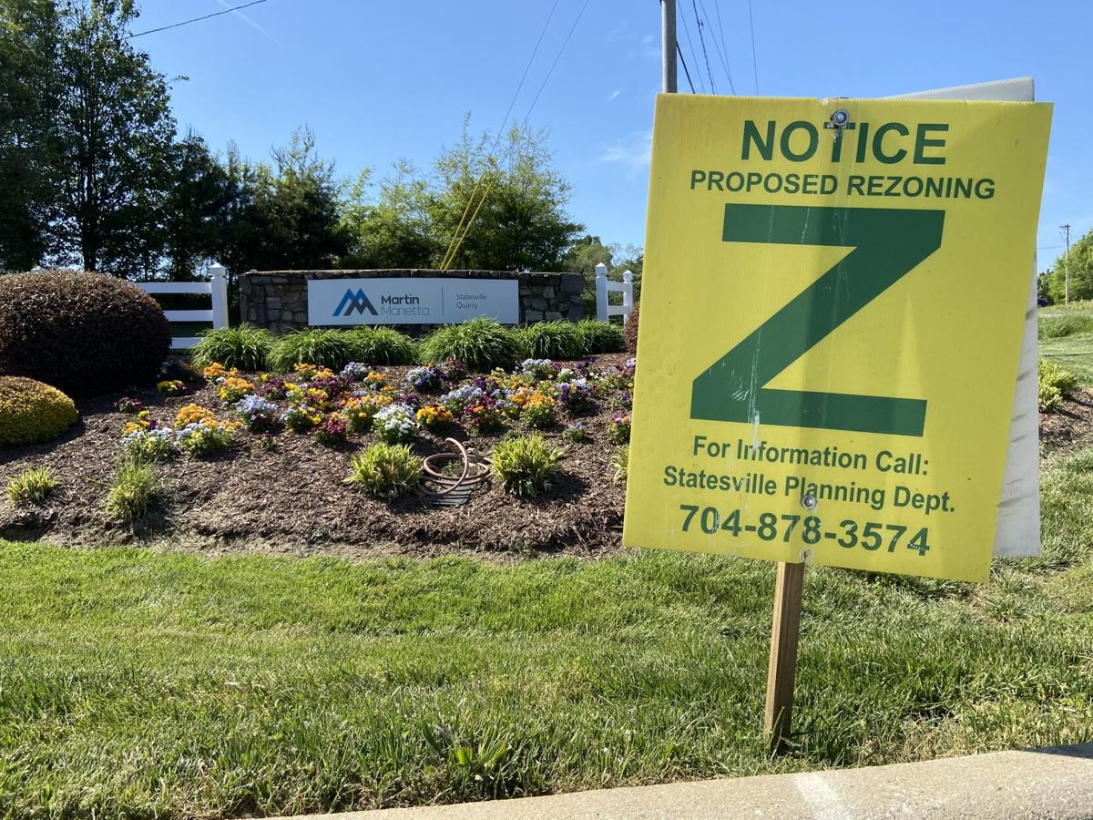 A sign notifying residents of a potential rezoning is placed near the entrance of Martin Marietta's quarry in Statesville.