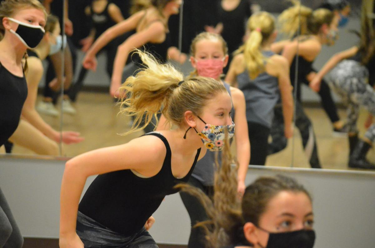 Students practice for an upcoming competition during a class at Statesville Dance in Statesville on Monday.