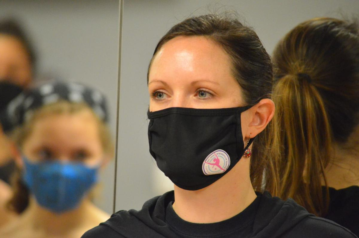Laura Hanson watches students dance at Statesville Dance in Statesville on Monday.