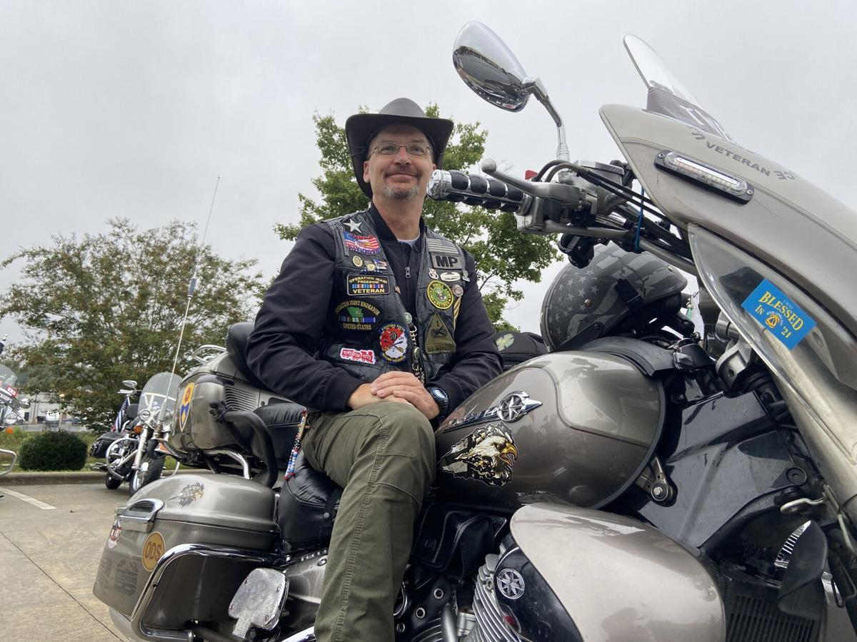 Jay Janish poses on his motorcycle on Saturday.