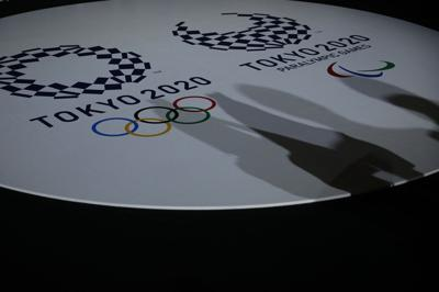 The emblems of the Tokyo 2020 Olympic and Paralympic Games are displayed during an event to unveil the medals, podium and music to be used for the medal ceremonies at the Tokyo 2020 Olympics Games at Ariake Arena in Tokyo on June 3, 2021.