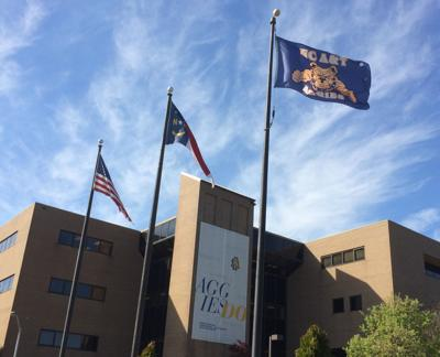 NCAT N.C. A&T college generic campus Dowdy Building with flags logo