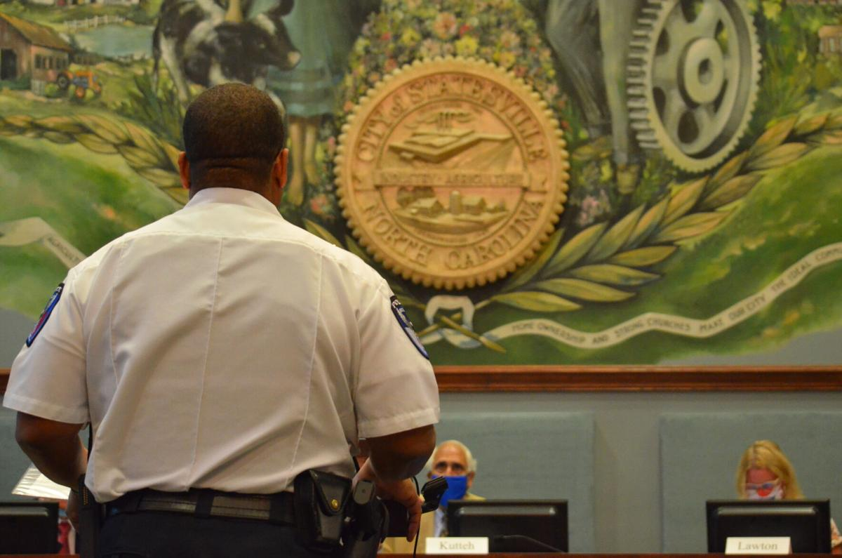 Statesville Police Chief David Addison speaks to the city council in Statesville on Monday.
