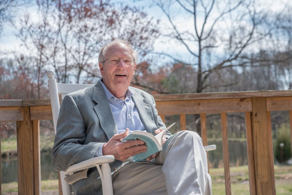 """William P. Pope sits with his book """"These You Know"""" in a promotional photo."""