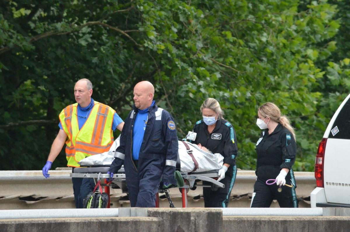 One of Atrium Health's MedCenter Air helicopter crews transports a patient after a wreck on Interstate 40 in June.