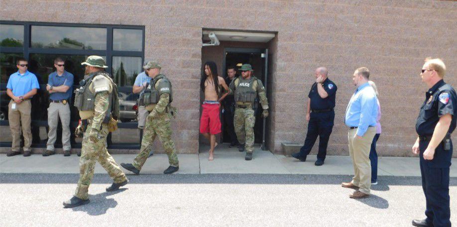 6-19 Officer shooting arrest.jpg