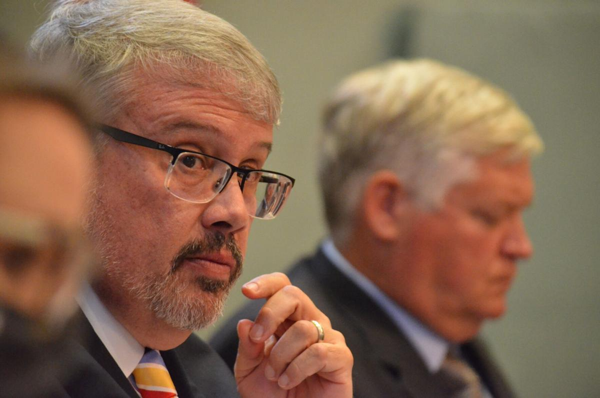 Statesville City Councilman William Morgan listens during a meeting on Monday.