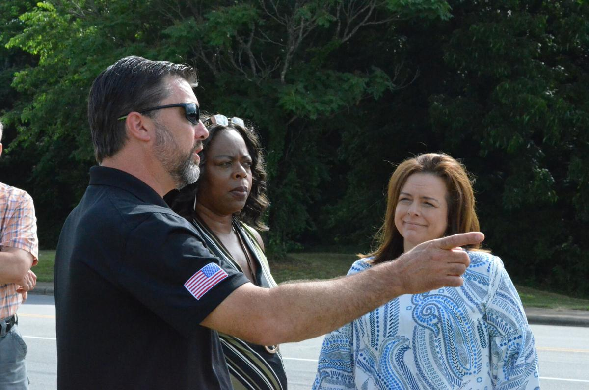 John Gallina of the Statesville Housing Authority speaks to North Carolina Sen. Vickie Sawyer, right, and Kim Wasson on Garner Bagnal Blvd. in Statesville on Friday.