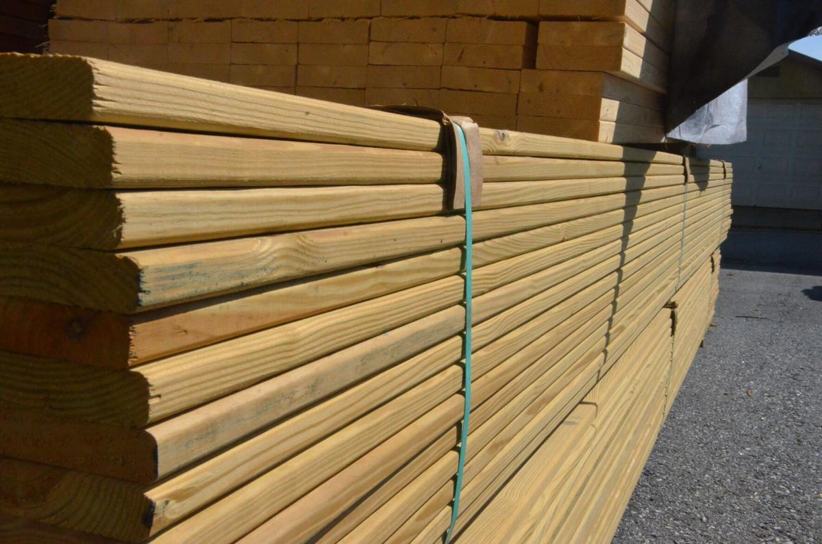 Dozens of boards are stacked at Union Grove Lumber in September. The lumber industry saw prices hit an all-time high this year.