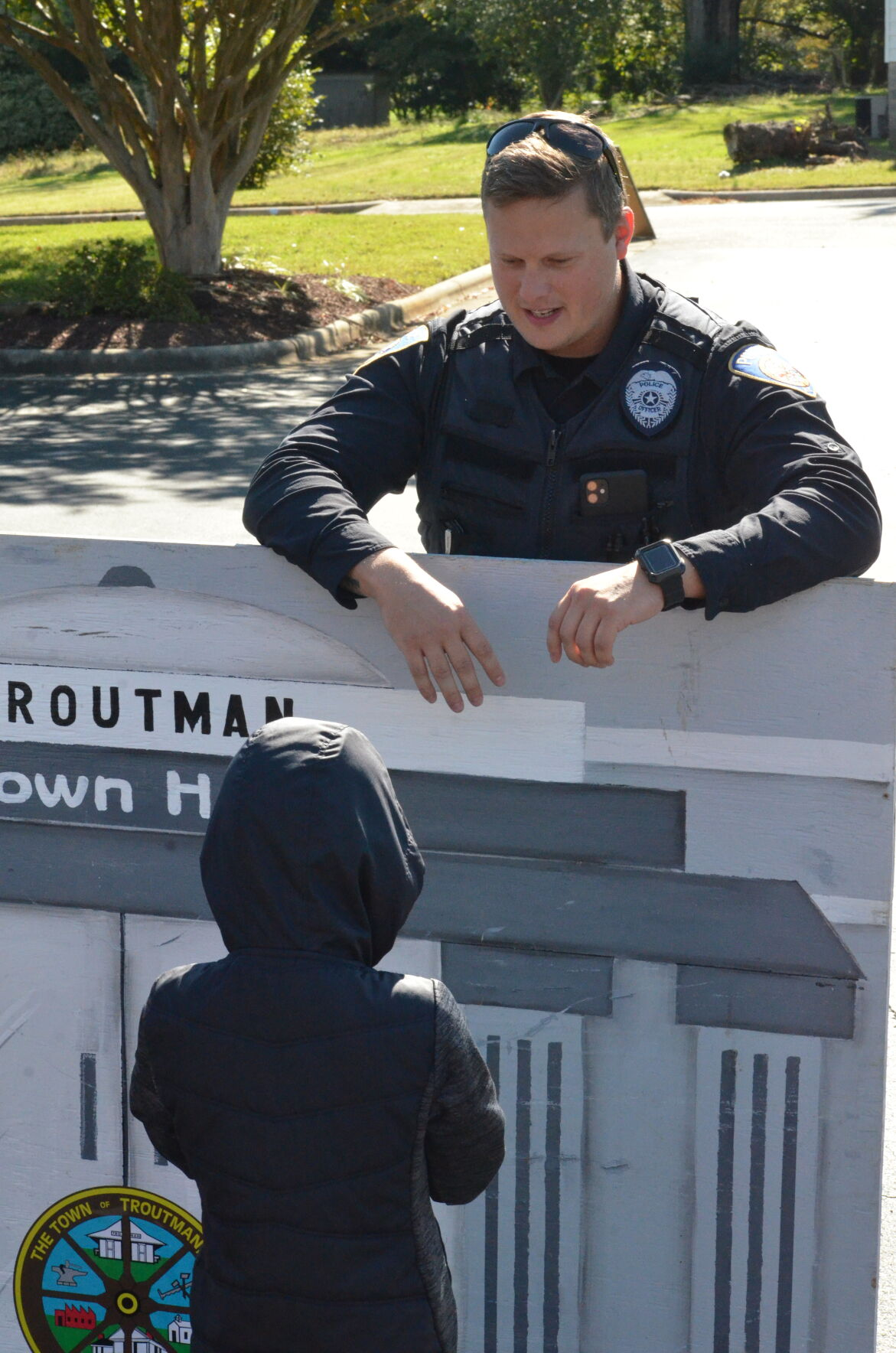 Officer Daniel Bova talks to Wyatt Adams during Troutman's National Night Out event on Saturday.