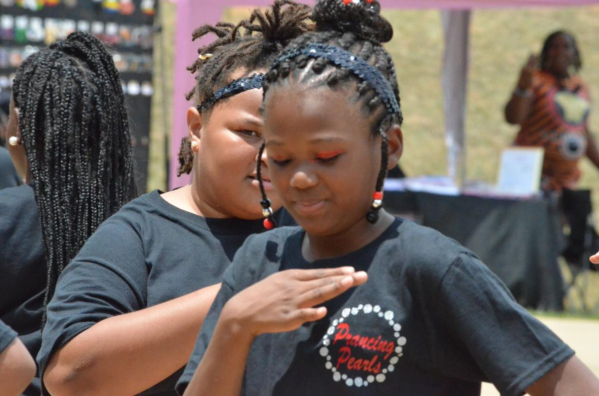 Aaliyah Nichols of the Prancing Pearls dance team performs at the Juneteenth celebration at Kimbrough Park in Statesville on Saturday.