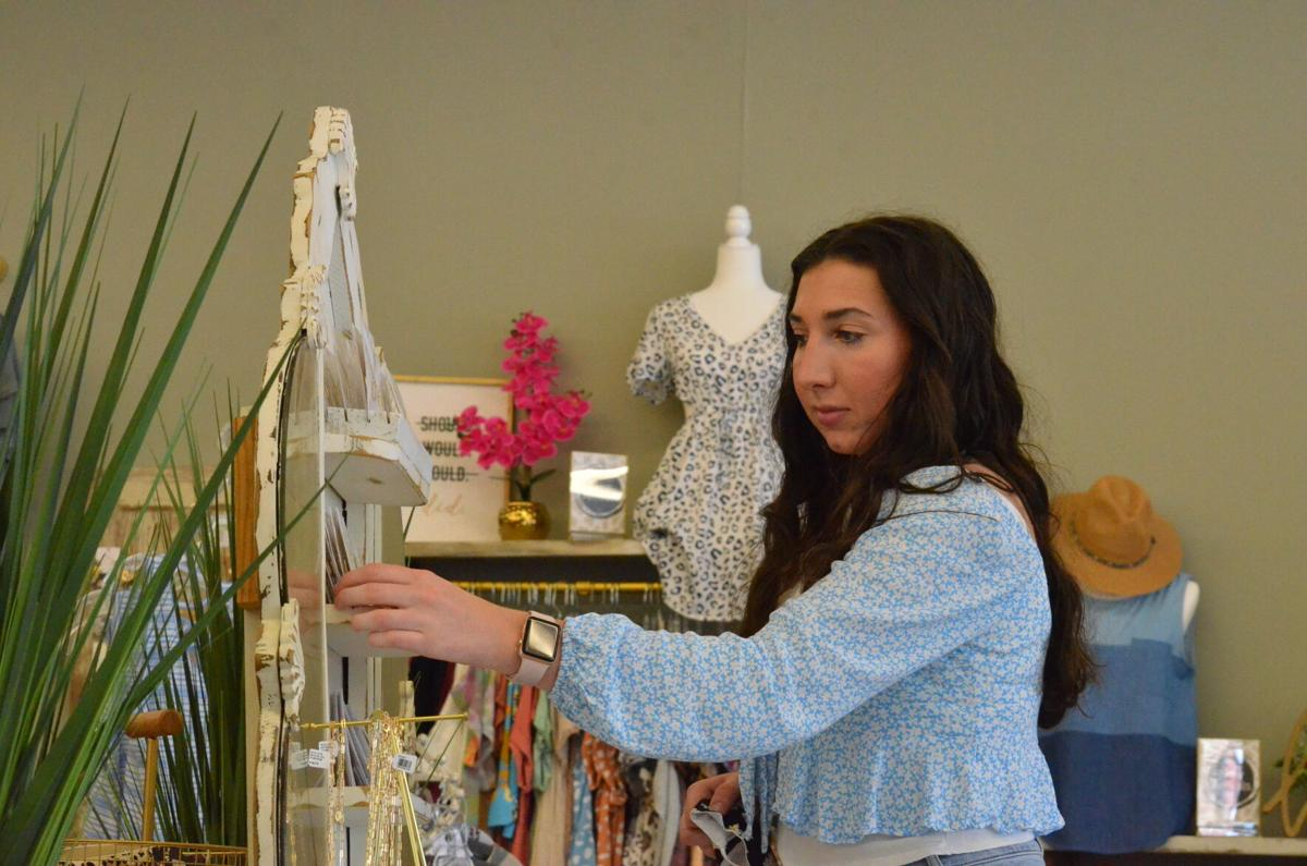 Caroline Blount looks at earrings and other accessories at Molly Malone's on Thursday in Statesville.