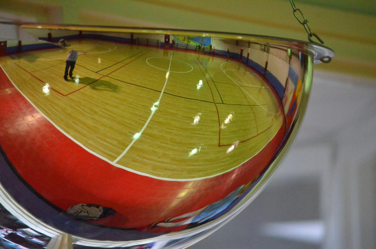 The new flooring at the Bentley Center is seen in a reflection on Tuesday in Statesville.
