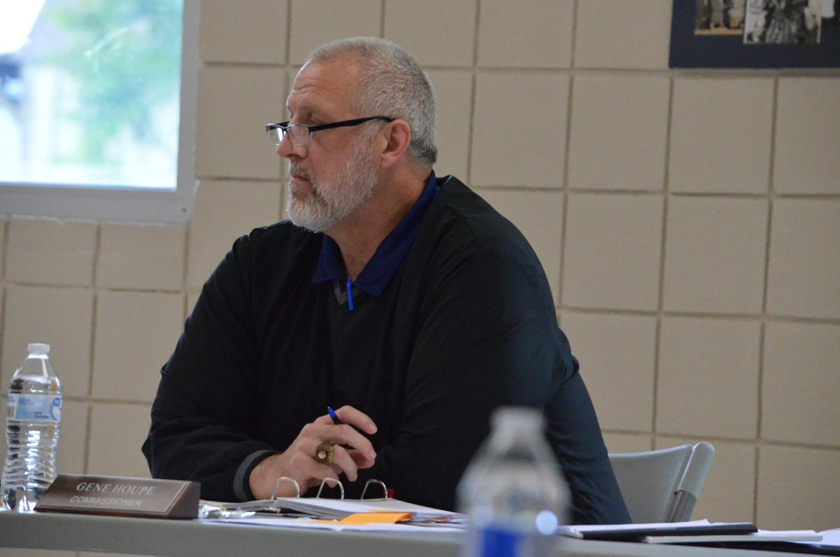 Gene Houpe looks on during Tuesday's budget meeting of the Iredell County Board of Commissioners in Statesville.