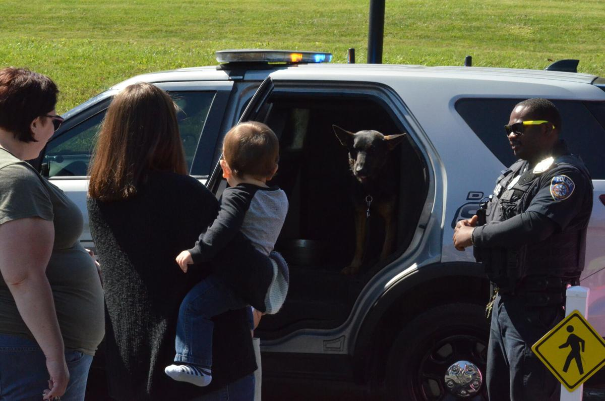 Officer James Scott introduces his canine companion, JP, during Troutman's National Night Out event on Saturday.