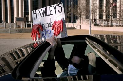 """""""Car-a-van"""" protest calls on Hawley to resign"""