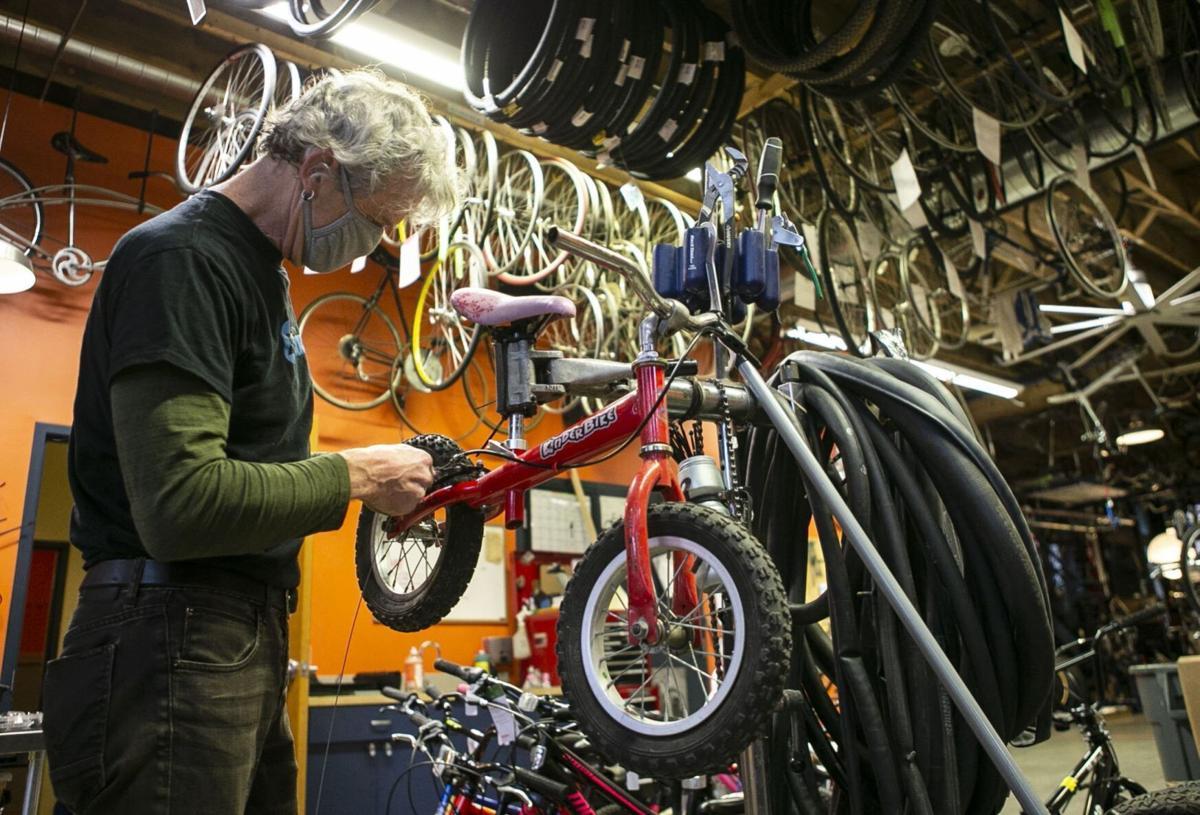 Volunteers and employees repair bikes at St. Louis BWorks in Soulard