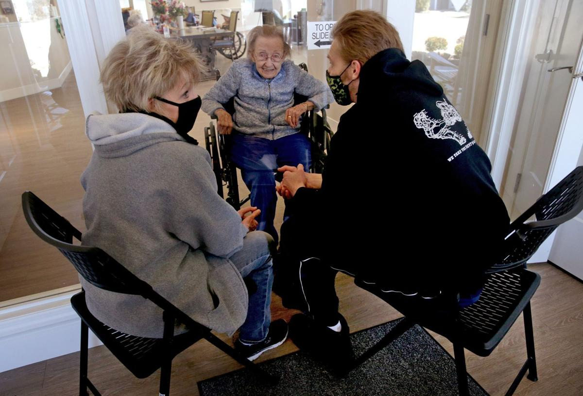 Families enjoy new indoor plexiglass visits at Cottages of Lake St. Louis