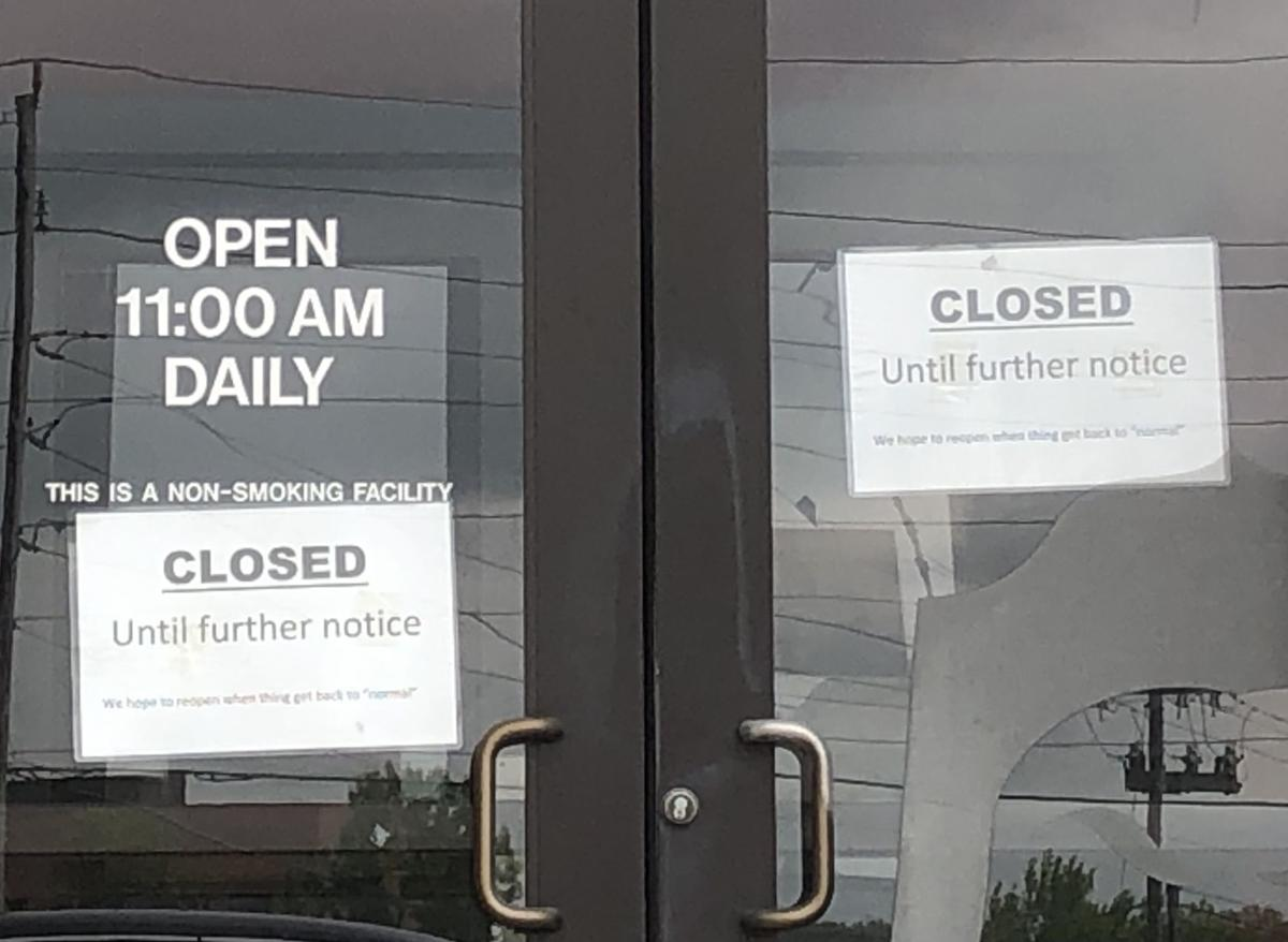 Closed signs at Hu Hot Mongolian Grill in Creve Coeur