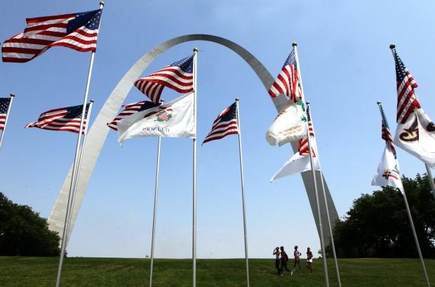Prep work for 32nd annual Fair St. Louis-Flags on display