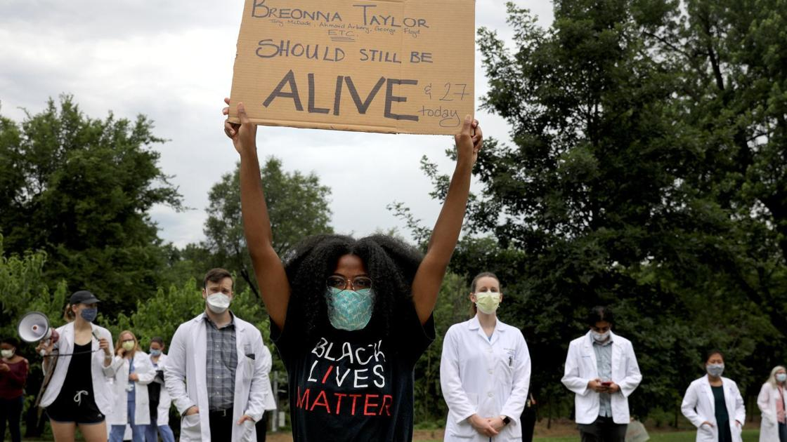 Watch now: St. Louis health care workers take to street in support of movement