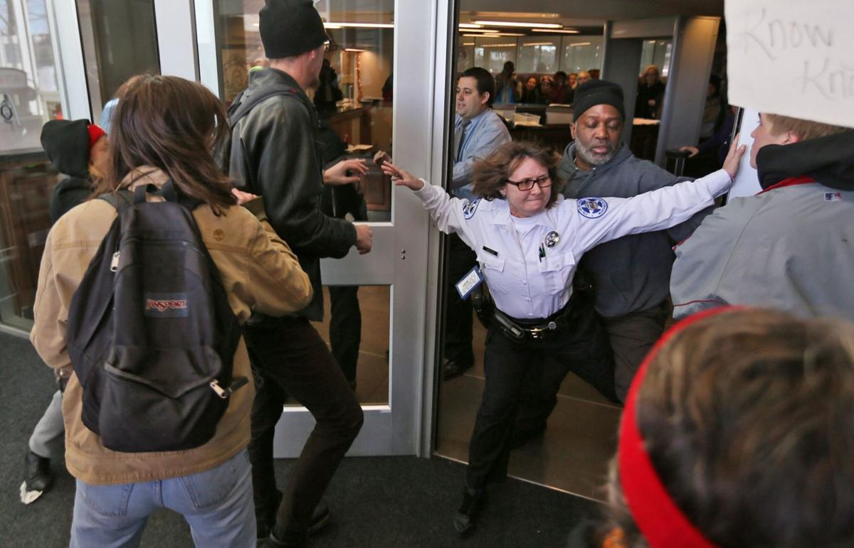 Protesters try to rush into St. Louis Police Headquarters