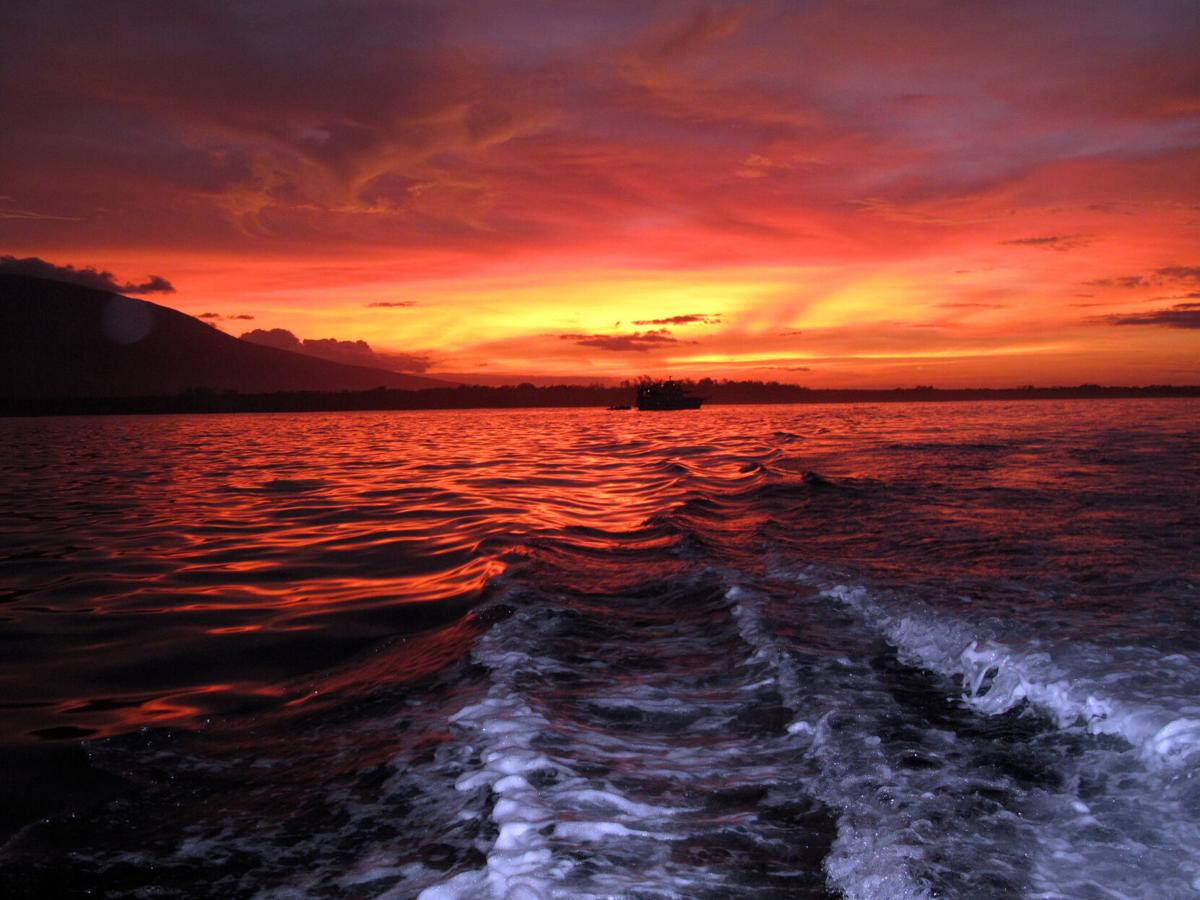 The setting sun fills the sky with color over Fernandina in the Galapagos Islands.