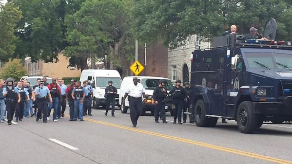 Police arrive in armored vehicle, order crowd to disperse