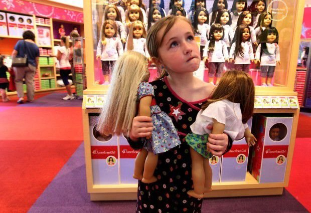Friends and Family Day at American Girl Store-  girl looking at display