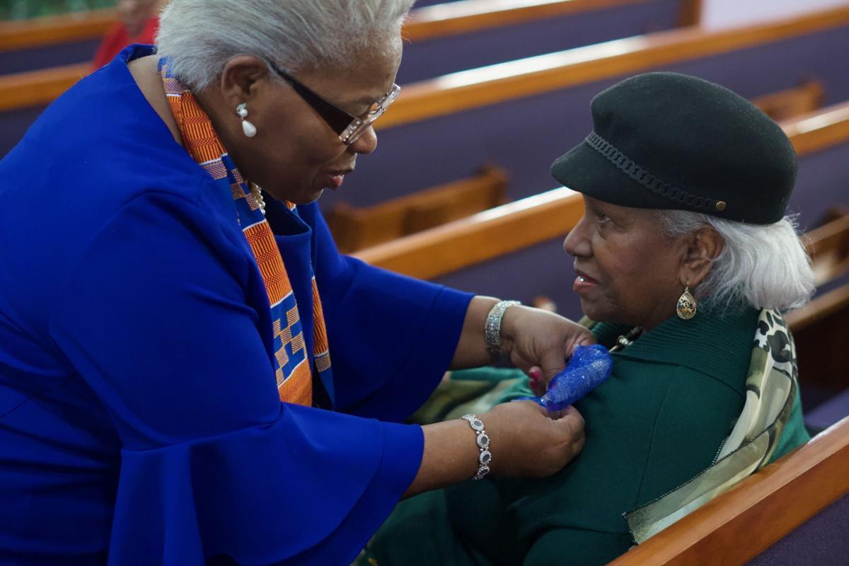 Joyce Elliott with parishioner