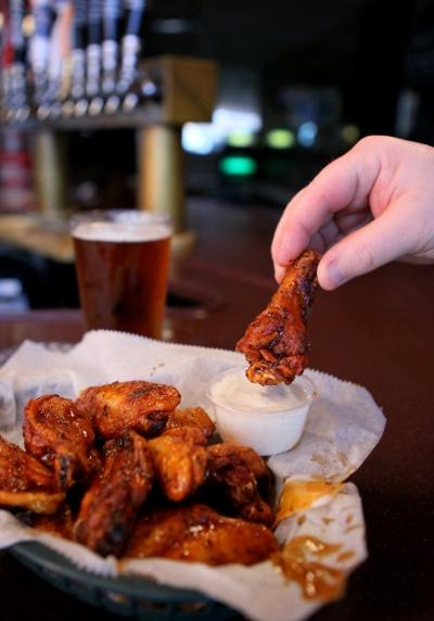 Peppery wings in hot sauce from Lemmons in St. Louis