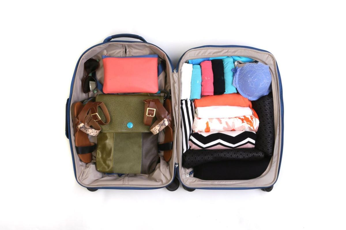 Pack 10 days of style in a carry on with room to spare How to pack a carry on suitcase video