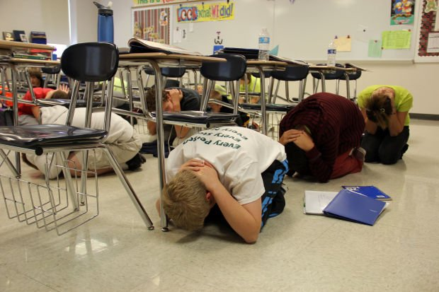 students in traci kaibel s eighth grade social studies class at wentzville south middle school drop and cover during the great central u s shakeout