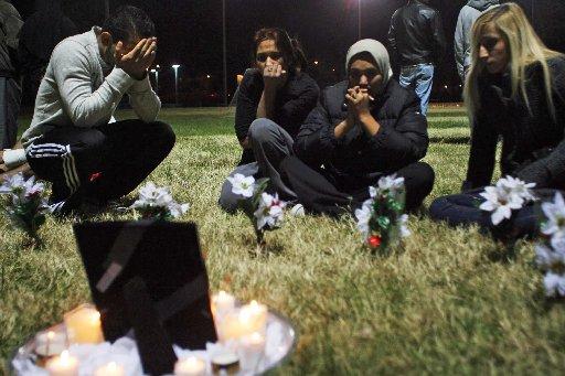 Mourners at a memorial for Karrar Abudarb