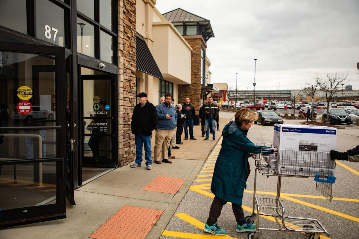 Lines form outside computer stores as people prepare to work from home during coronavirus outbreak