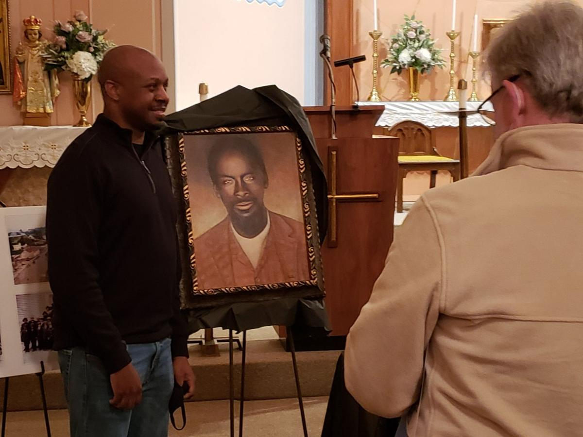 Brant Riney of Florissant stands before a modern portrait of Moses Riney