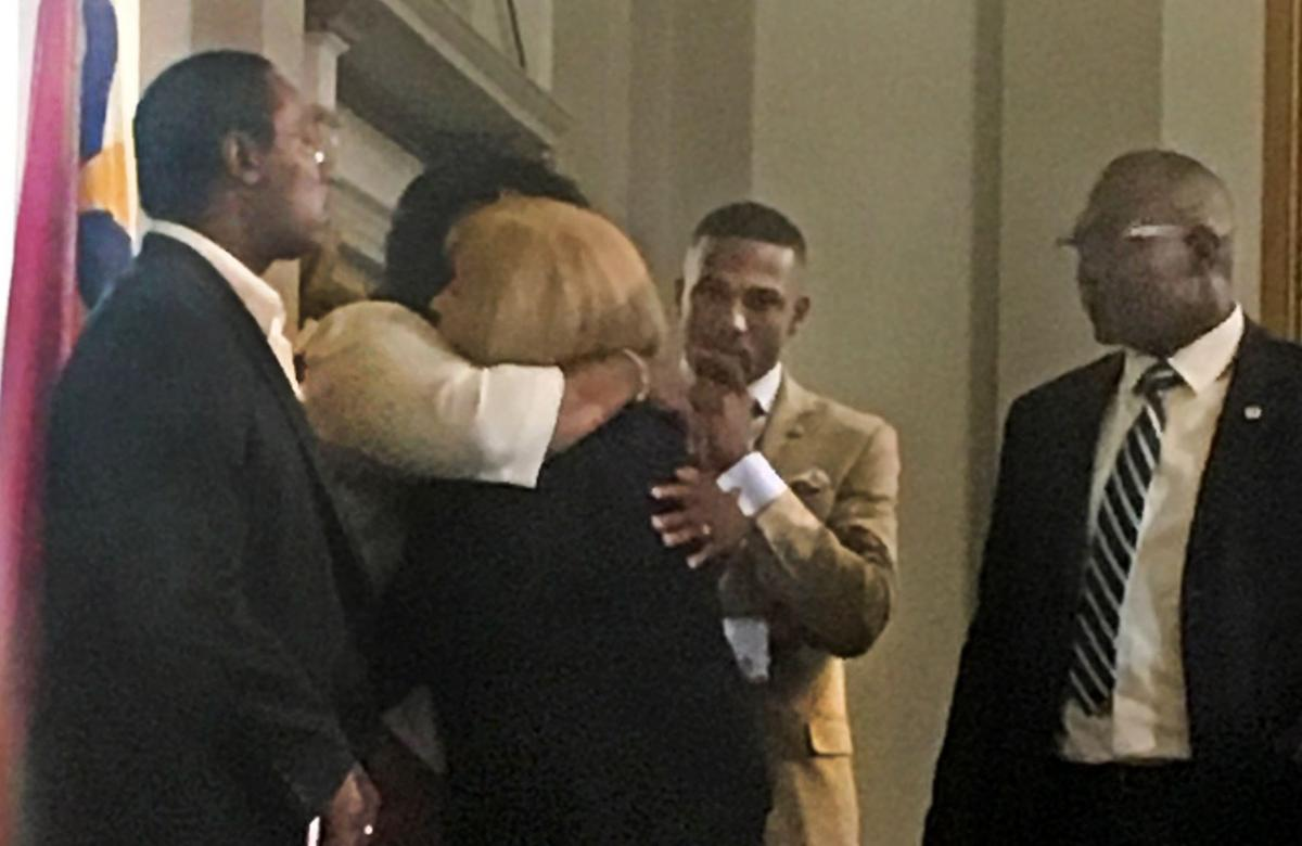 Mayor Krewson hugs Annie Smith after city meeting