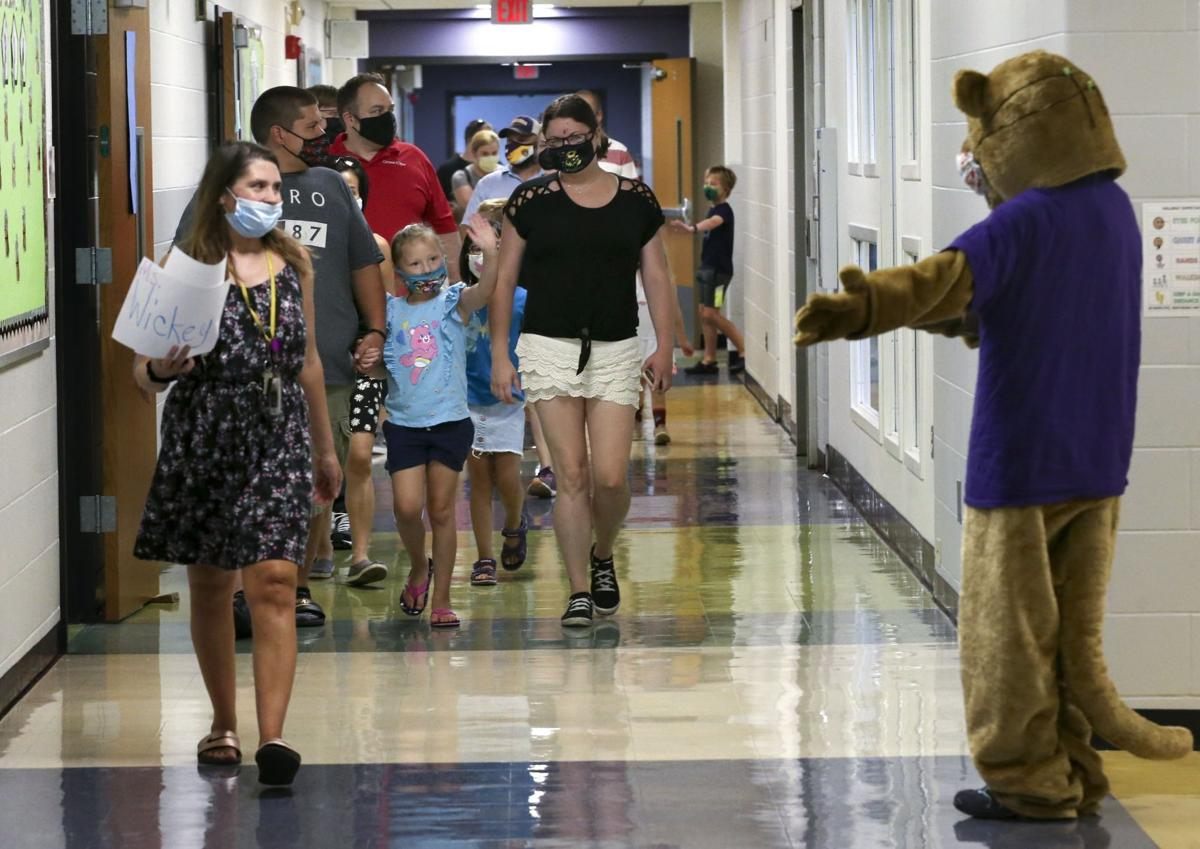 Waving to the Cougar mascot during open house