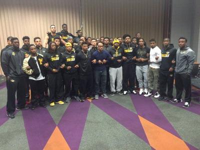 Missouri football players pose for a photo posted by the school s Legion of  Black Collegians Twitter account. d26a0648f