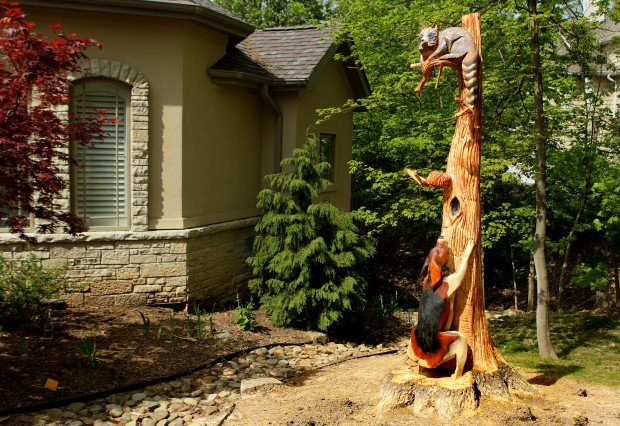 Creative ideas for tree stumps home and garden for Tree trunk slice ideas
