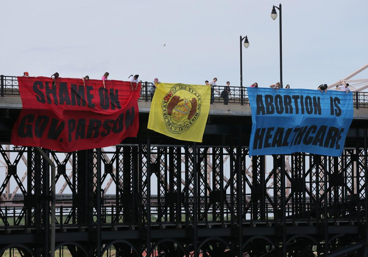 Abortion-rights activists put banners on Eads Bridge