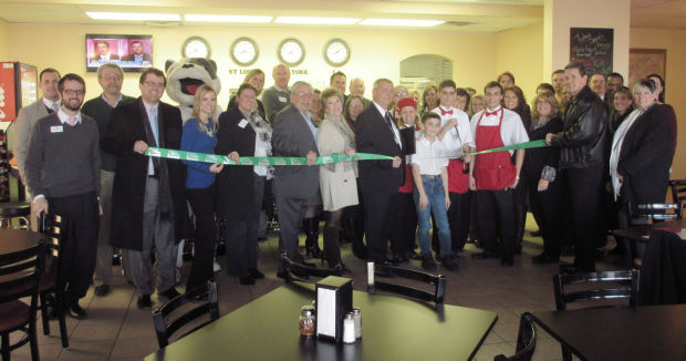 Businesses hold ribbon cuttings