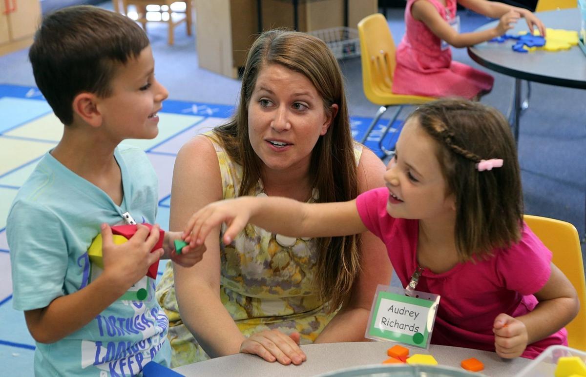 Kindergarten teacher talks to students at Oak Brook Elementary