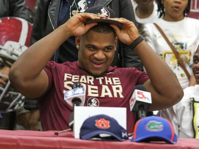 b86e5385687 Henry picks Florida State as Trinity celebrates special senior class ...