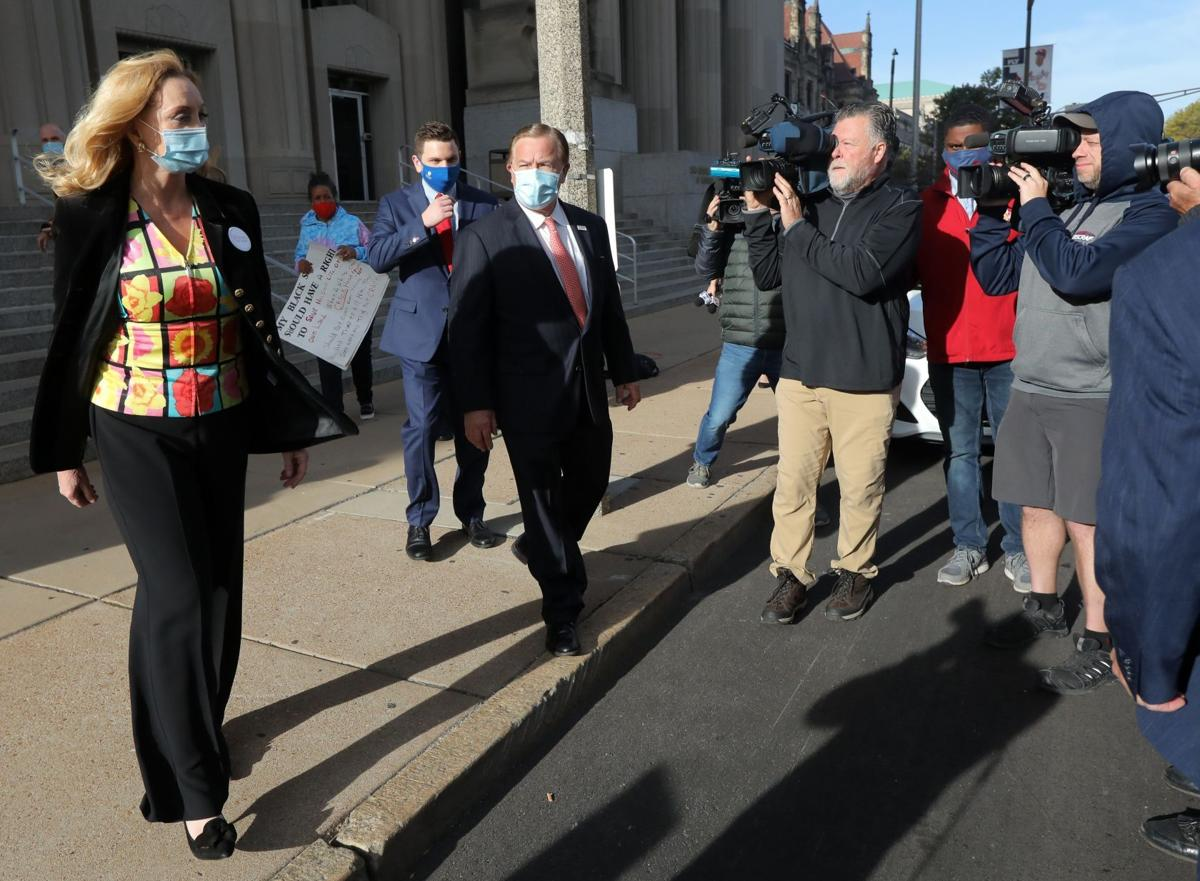 Gun-waving St. Louis couple plead not guilty to gun and tampering charges