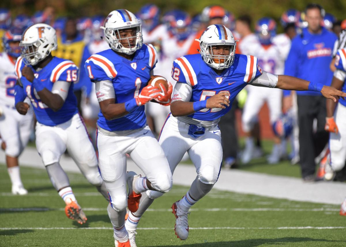East St. Louis defeats Hoffman Estates in first round football playoff game