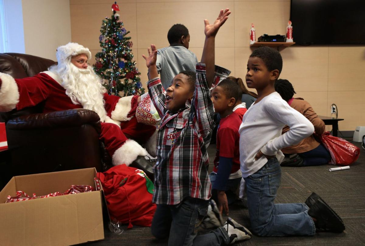 police officers provide early christmas for ferguson kids local