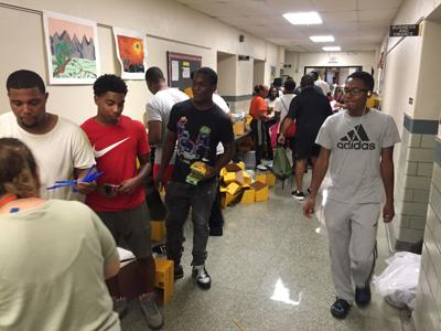 Couple donates 750 backpacks to St. Louis schools.