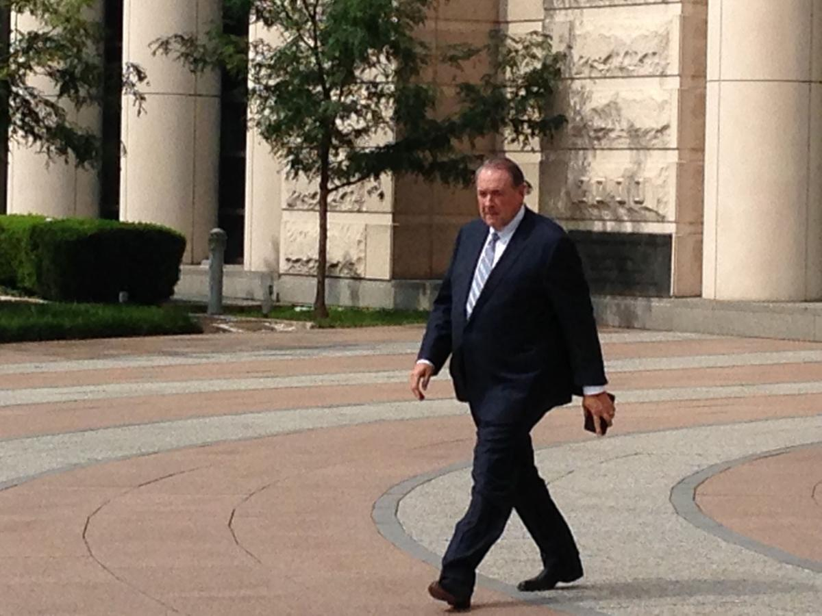 Former Arkansas Gov. Mike Huckabee leaves federal court in St. Louis